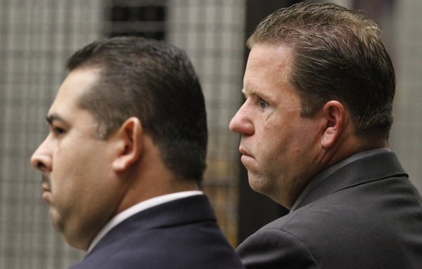 Former Fullerton police officers Manuel Anthony Ramos (left) and Jay Patrick Cicinelli in court in 2012. (Don Bartletti / Los Angeles Times / June 26, 2012)