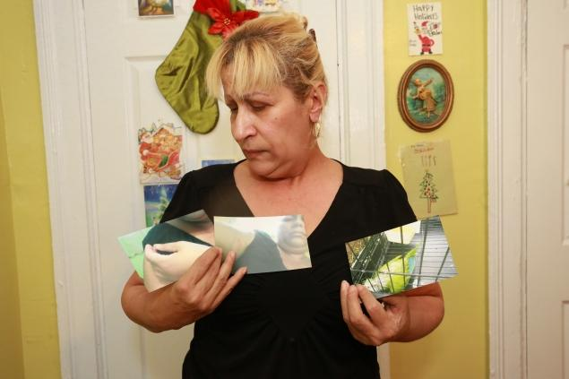 Evelyn shows photos of her parakeet, Tito. Source: NY Daily News.