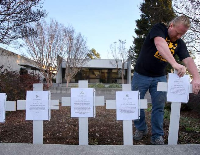 Forrest Schmidt planted crosses in the ground to represent each human being who has died in the custody of police in Sonoma County. Photo Source: Christopher Chung - The Press Democrat
