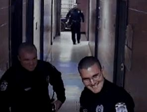 The officers can be seen smiling with pleasure after the boy's head was rammed into a wall.