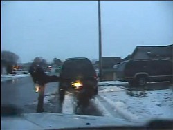 The officer can be seen on the dashcam kicking the dog as the dog yelped.
