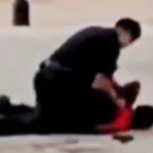 Cop Caught on Video Sitting on Handcuffed Man and Trying to Break Both of His Arms