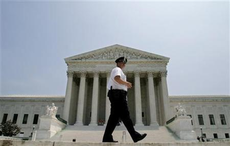 Police officer patrols outside US Supreme Court in Washington after Justice O'Connor announced her ...