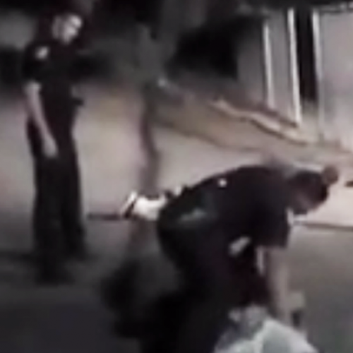 Officer Beats and Kicks Handcuffed Military Veteran, Drags His Body Through the Dirt (Video)