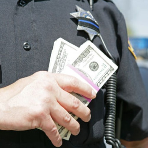 Cop pleads guilty to robbing eight drug dealers