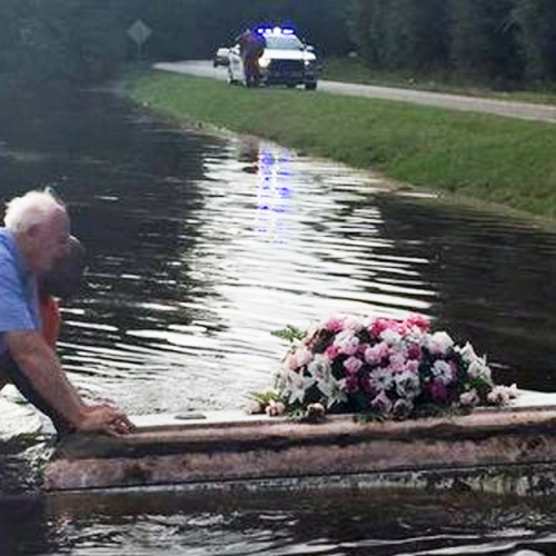 Pastor DEFIES Cop's Orders, Saves Casket Drifting Away In Flood