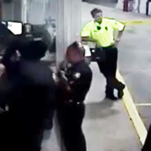 Cop Beats Handcuffed Woman, Fellow Officers Stand There and Watch