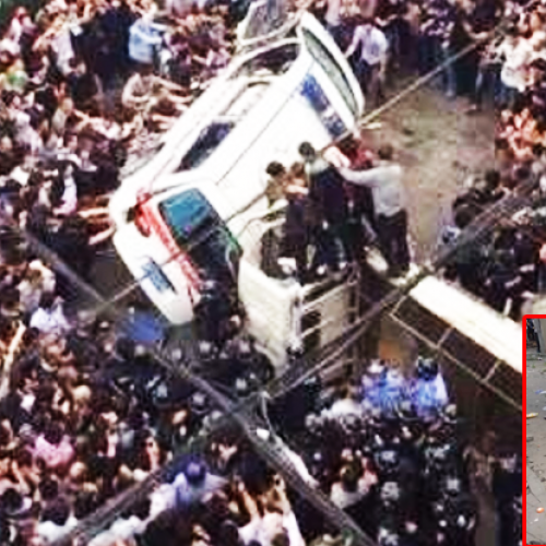 China: Cops Beat a Woman, Thousands of Men Begin Stoning Cops in Streets