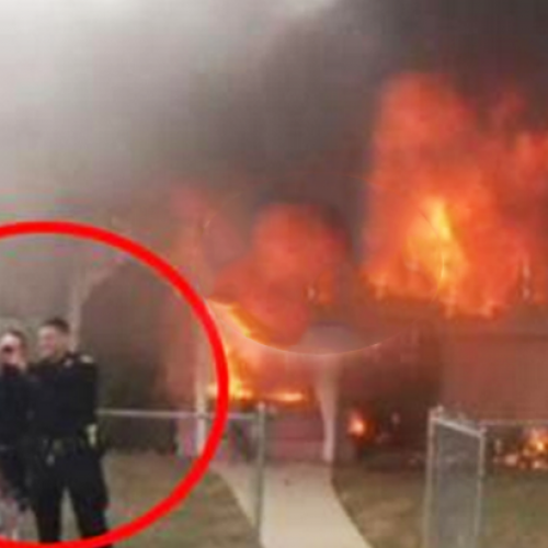 Neighbors Furious After Video Shows Cops Take Laughing Selfie in Front of a Burning Home