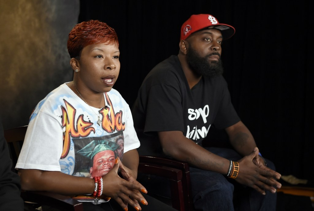 FILE - In this Sept. 27, 2014, file photo, the parents of Michael Brown, Lezley McSpadden, left, and Michael Brown Sr., sit for an interview with The Associated Press in Washington. A federal judge on Tuesday, June 20, 2017, approved a settlement in the wrongful-death lawsuit filed by the parents of Michael Brown, an unarmed, black 18-year-old, whose fatal shooting by a white police officer nearly three years ago in Ferguson, Missouri, set off months of protests. (AP Photo/Susan Walsh, File)