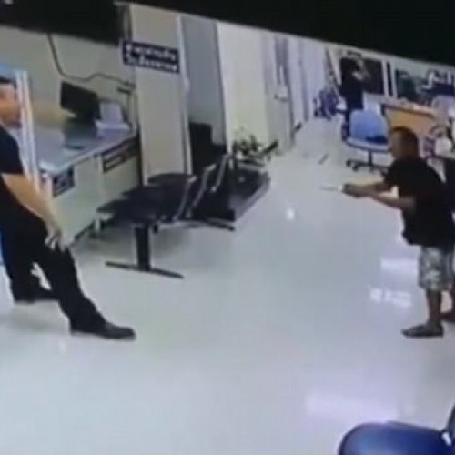 Thai Cop Calms Knifeman With Hug Inside Bangkok Police Station