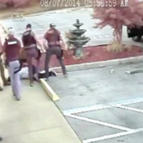 WATCH: Cops Caught on Camera in Cowardly Gang-Style Beating of an Unarmed Man Lying Face Down