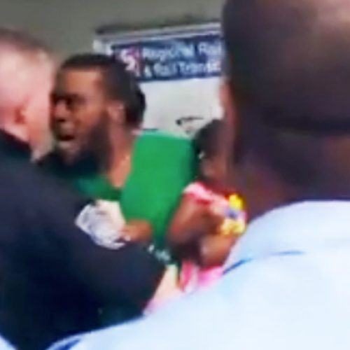 WATCH: Mob of Philly Cops Assault Man Holding Crying Baby For Not Paying His $2.25 Transit Fare