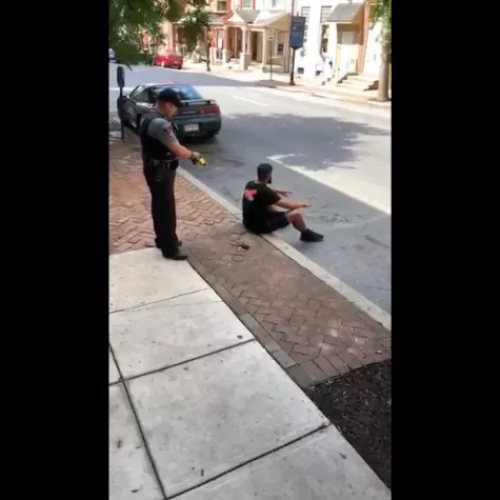 WATCH: Cop Caught on Video Firing Taser at a Calm, Nonviolent, Compliant Man Who Was Sitting on a Curb